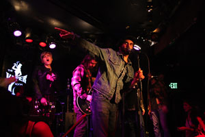 PHOTO CAPTION(L-R): Lead singer Morty Coyle, of All Day Sucker performing with Dave Grohl of The Foo Fighters at L.A.'s The Viper Room. Photo Courtesy of Luck Media & Marketing, Inc.