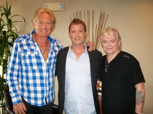 PHOTO CAPTION (L-R): GRAHAM RUSSELL; KTLA-TV guest host BRIAN MCFADDEN; and RUSSELL HITCHCOCK on July 30. CREDIT: LUCK Media & Marketing, Inc.