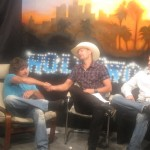 "PHOTO CAPTION: Coldwater Canyon Band frontman Howie Vaughn and fellow band member Brandon Fisher being interviewed by former Howard Stern entertainment reporter Gary Garver for an upcoming episode of ""Gary Garver Live."""