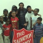 Singer-songwriter Sharif Iman (middle) pictured with participants at Nashville's Salvation Army facility.