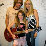 """PHOTO CAPTION: Billy Ray Cyrus  and wife Tish presented their daughter Miley  with a Daisy Rock Girl Guitar  during Cyrus' press conference at the CMA Music Festival  in Nashville on June 13th.  The 12 year old aspiring guitarist and actress ( Big Fish , PAX TV's Doc)  becomes one of the youngest """"tweener"""" spokesperson's to endorse the one and only girl guitar company. (Photo courtesy of Luck Media & Marketing, Inc.)"""