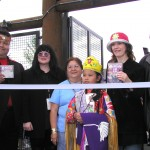 "PICTURED: Ann and Nancy Wilson of HEART present Muckleshoot Indian Tribe leader John Daniels, Jr. with copies of their new ""Alive in Seattle"" DVD and CD/SACD at the opening day ribbon-cutting ceremony for White River Ampitheater in Auburn Washington. L-R are Daniels, Ann Wilson, tribal princesses, Nancy Wilson, and Gregg Perloff, President of Bill Graham Presents/Clear Channel Entertainment."