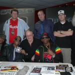 "Pictured at an in-store appearance at Las Vegas' Zia Record Exchange (seated) left to right, Dewey Cooper, President/CEO Head Trauma Records; Canibus, Morey Alexander, President/CEO Kent Entertainment; Phoenix Orion, (standing), left to right, Karl Hartwig, Manager Las Vegas Operations, Zia Record Exchange; Chris Madsen, AE Hot 97.5 radio; Zak Frankel, Zia Records; and Tristan ""Doc"" Dubois, Director of Business Development, Kent Entertainment."