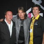Billy Ray Cyrus (center) congratulated for a great audience turnout backstage at the San Diego Country Fair by Jim Gosnell/President of Agency For The Performing Arts (APA) (left) and Tim Fennell General Manager of the Del Mar Fairgrounds (right).