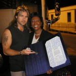 """Councilwoman Lynette Boggs McDonald proclaims Billy Ray Cyrus an """"Honorary Citizen of Las Vegas"""" and hands him the """"key to the city."""""""