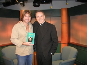 (L-R) are: Billy Ray Cyrus and host Rev. Monsignor James Lisante.