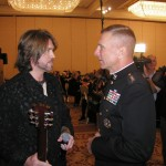 PICTURED LEFT TO RIGHT: 2003 Honorary Toys for Tots Spokesperson, Billy Ray Cyrus shares a few words with U.S. Marine Corps, Commandant General Michael W. Hagee. (Photo courtesy Luck Media & Marketing, Inc.)