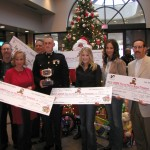 PICTURED LEFT TO RIGHT : Country singer Sherrie Austin, Executive Director of CMA Ed Benson, Country singer Tammy Cochran, President Toys for Tots of Middle Tennessee Rob Kohls, Captain Thomas S. Little II, Santa Claus, Country singers Lila McCann and Memarie, and President Jeff Diamond of the Tennessee Titans.