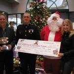 Pictured left to right: T4T's Middle TN. President Rob Kohls, Marine Captain Thomas S. Little II, Santa Claus and Lila McCann.
