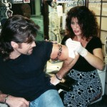 Thanks to a tip from Heidi Mark, whose real life boyfriend is the heavily tattooed Vince Neil of Motley Crue fame, it was off to Sunset Tattoo on the world famous Sunset Strip in Hollywood. Cyrus opted for a black tribal armband on his left bicep from ink-slinger to the stars, Lisa Bernabe, whose clients include Dennis Rodman, LL Cool J., baseball star Bobbie Bonilla, Robin Quivers from the Howard Stern Show, actor Daniel Baldwin, to name a few.