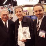 PHOTO CAPTION: (L-R) Keith Mardak, Keith Wyatt, Jeff Schroedl - Hal Leonard Chairman and CEO Keith Mardak and Vice President, Pop & Standard Publications Jeff Schroedl present anniversary plaque to Musicians Institute Director of Programs Keith Wyatt at 2007 Winter NAMM show