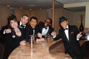 PHOTO CAPTION (right to left): DAVID DECOSTA  (Frank Sinatra), TONY BASILE (Dean Martin), SANDY HACKETT (Joey Bishop), DOUG STARKS (Sammy Davis, Jr.) of SANDY HACKETT'S RAT PACK SHOW