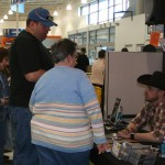 PHOTO CAPTION:  Minneapolis-based rising country star Shane Wyatt signing autographs for fans at the Best Buy in Maple Grove, MN 3/21/09