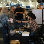 PHOTO CAPTION:  Minneapolis-based rising country star Shane Wyatt signing autographs for fans at the Best Buy in Maple Grove, MN