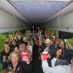 "PHOTO CAPTION: Minnesota country music fans enjoying free drinks onboard the ""Shane Train"" en route to the Surf Ballroom in Clear Lake, IA."