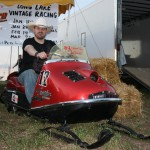 PHOTO CAPTION: Minneapolis Country music favorite Shane Wyatt checking out one of the snowmobiles at Outlaw Grass Drag in Princeton, MN on 8/22/2008