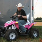 PHOTO CAPTION: Minneapolis Country music favorite Shane Wyatt showing his tough but feminine side at Outlaw Grass Drag in Princeton, MN.
