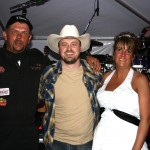 "PHOTO CAPTION: Minneapolis-based rising Country star Shane Wyatt with newlyweds Gary and Leann Beardslee during their wedding reception on September 9th, which was taped for an episode of CMT's  upcoming series ""My Big Redneck Wedding"", hosted by Tom Arnold."